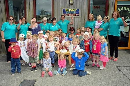 The children and staff of Sunny Days celebrating their 30th Anniversary