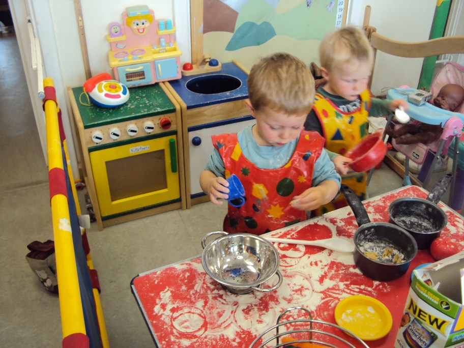 Children playing together in the food preparation area